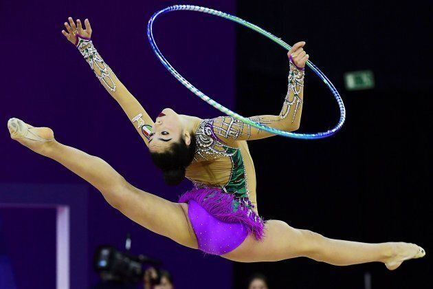 epa05974578 Alexandra Agiurgiuculese of Italy performs with the hoop during the individual qualification...