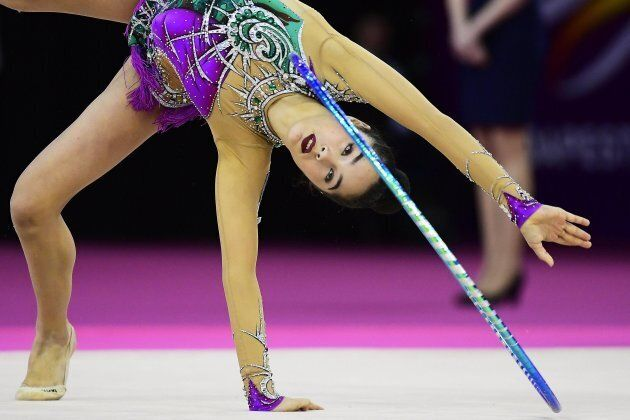 epa05974587 Alexandra Agiurgiuculese of Italy performs with the hoop during the individual qualification...