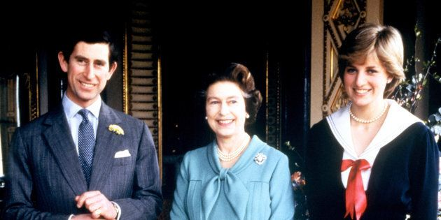 Queen Elizabeth II poses for photographs with the Prince of Wales and his fiancee, Lady Diana Spencer...