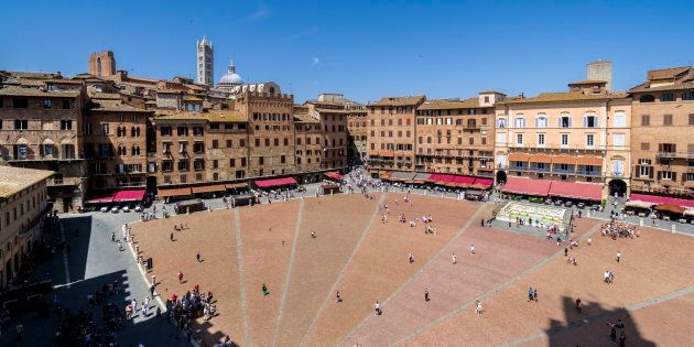 SIENA, TUSCANY, ITALY - 2016/05/27: View on the Piazza del Campo and surrounding buildings, seen from...