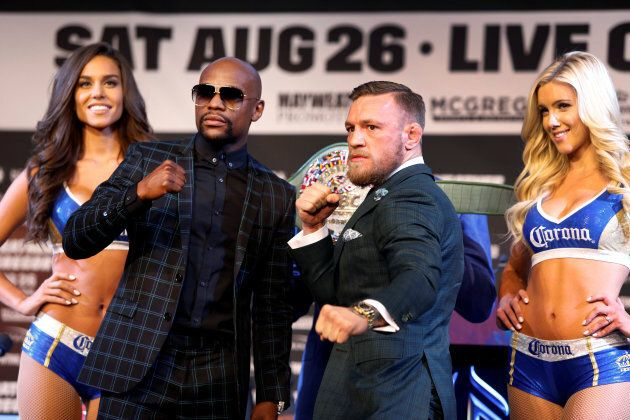 Floyd Mayweather Jr. (L) of the U.S. and Conor McGregor of Ireland pose during a news conference in Las...