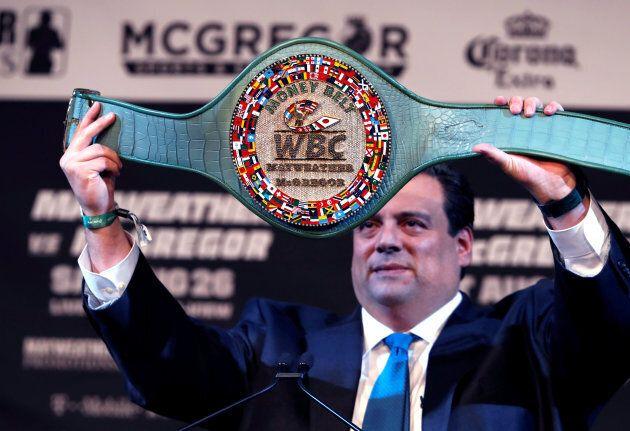WBC President Mauricio Sulaiman holds up the WBC