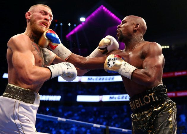 Aug 26, 2017; Las Vegas, NV, USA; Floyd Mayweather Jr. lands a hit against Conor McGregor during a boxing...