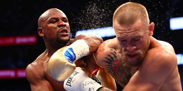 Aug 26, 2017; Las Vegas, NV, USA; Floyd Mayweather Jr. lands a hit against Conor McGregor during their...