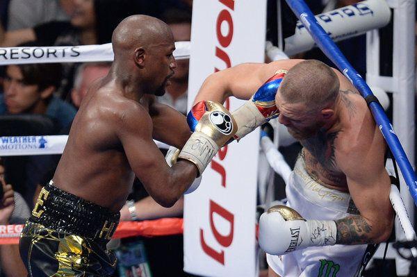 Aug 26, 2017; Las Vegas, NV, USA; Floyd Mayweather Jr. (black trunks) and Conor McGregor (white trunks)...