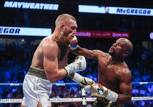 Nevada , United States - 26 August 2017; Floyd Mayweather Jr, right, and Conor McGregor during their...
