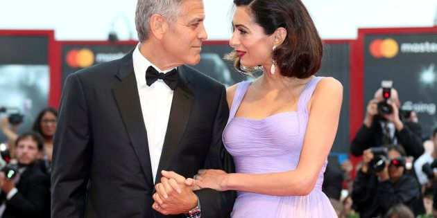 George Clooney, left, and Amal Clooney pose for photographers upon arrival at the premiere of the film...