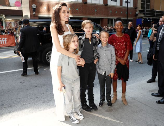 Executive producer Angelina Jolie arrives with her children on the red carpet for the film