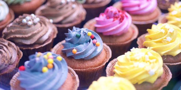 Colorful cupcakes in window display in