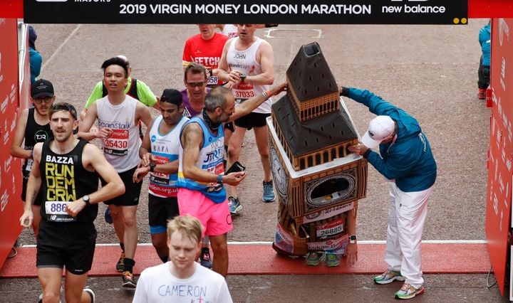 Lukas Bates had a towering presence at the London Marathon and was helped under the arch at the finish.