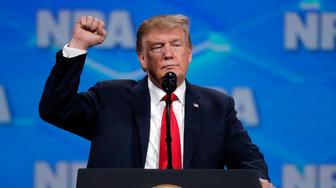 President Donald Trump speaks at the National Rifle Association Institute for Legislative Action Leadership Forum in Lucas Oil Stadium in Indianapolis, Friday, April 26, 2019. (AP Photo/Michael Conroy)