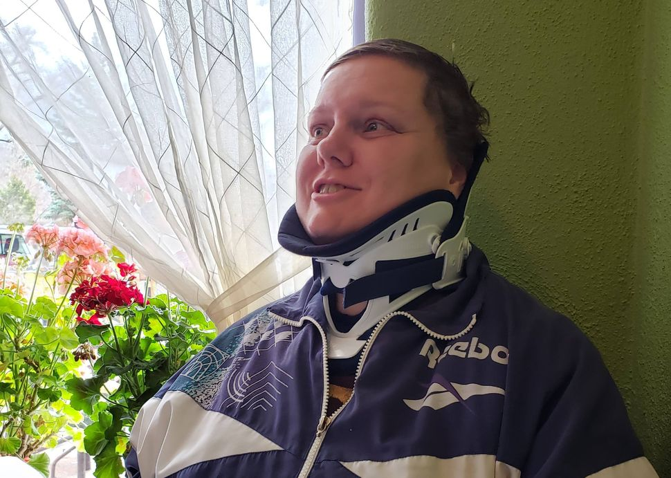 Hunt wearing a brace to stabilize her neck after suffering a C7 transverse process fracture in her back and several torn liga
