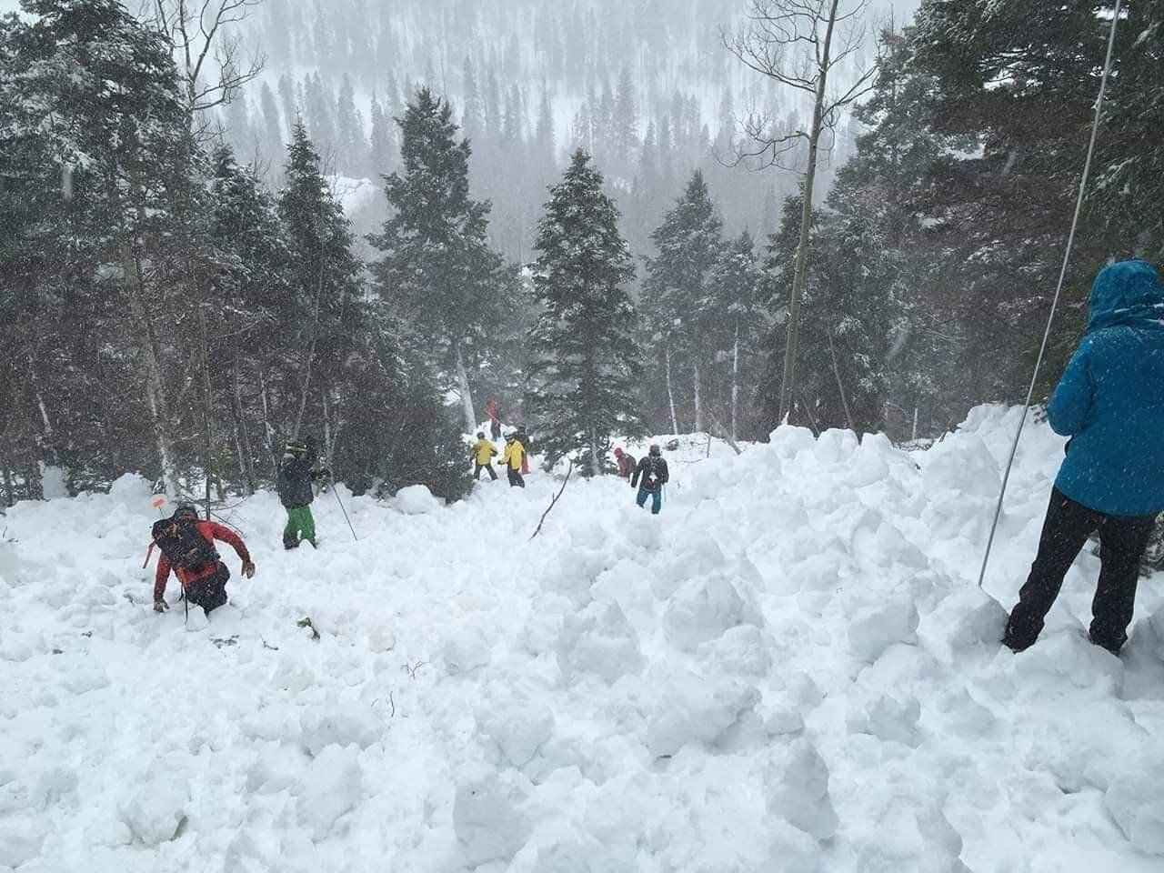 Rescue workers looking for bodies after an avalanche in the Taos Ski Valley in New Mexico on March 13, 2019.