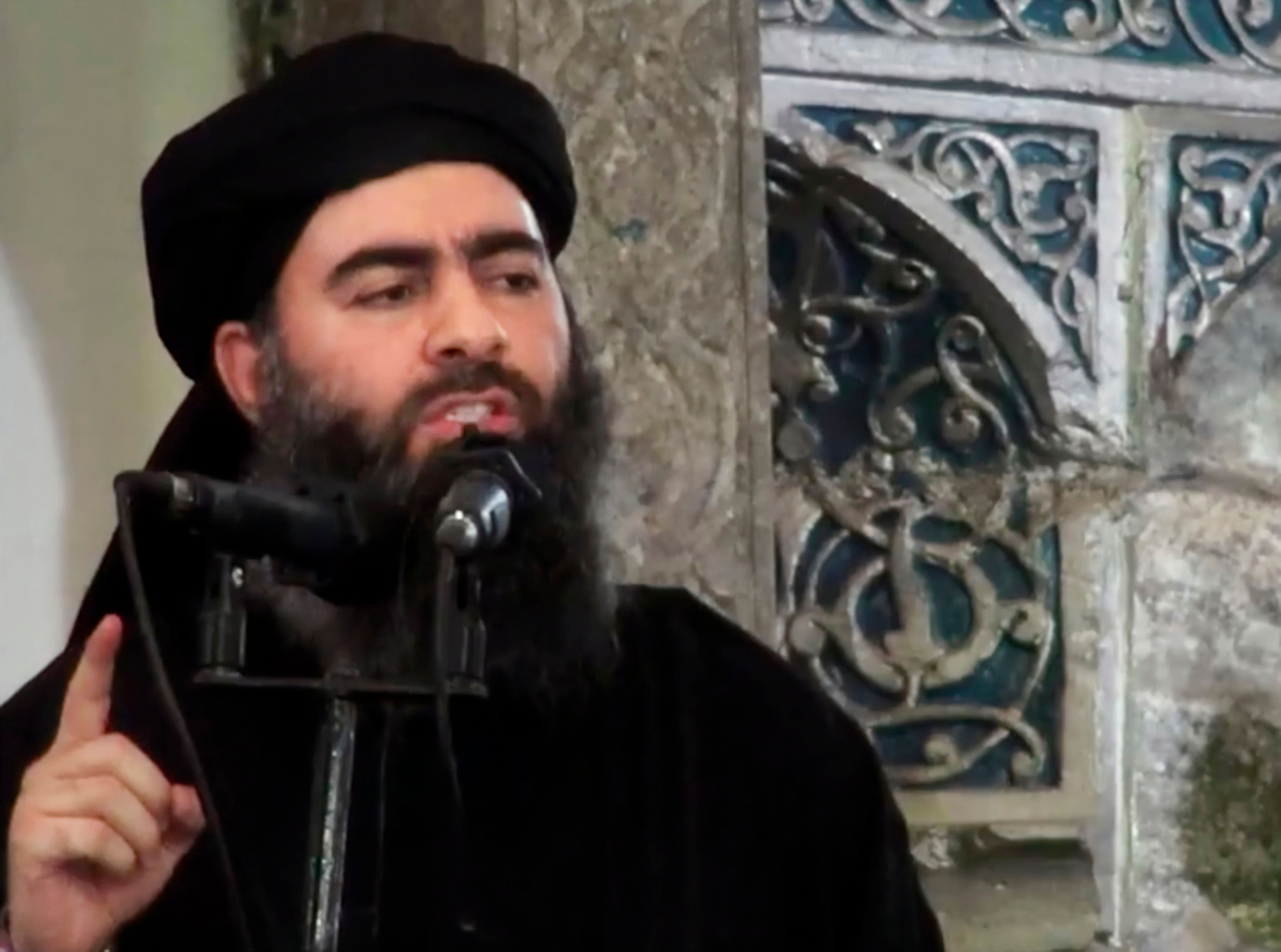 FILE - This image made from video posted on a militant website July 5, 2014, purports to show the leader of the Islamic State group, Abu Bakr al-Baghdadi, delivering a sermon at a mosque in Iraq during his first public appearance. President Donald Trump declared victory over the Islamic State group in Syria in a tweet Thursday, Dec. 20, 2018, but the militants remain a deadly force, and U.S. partners warn a premature U.S. withdrawal will allow them to storm back. The jihadists still hold territory in Syria and top leaders, including the group's self-styled caliph Abu Bakr al-Baghdadi, remain at large. (Militant video via AP, File)