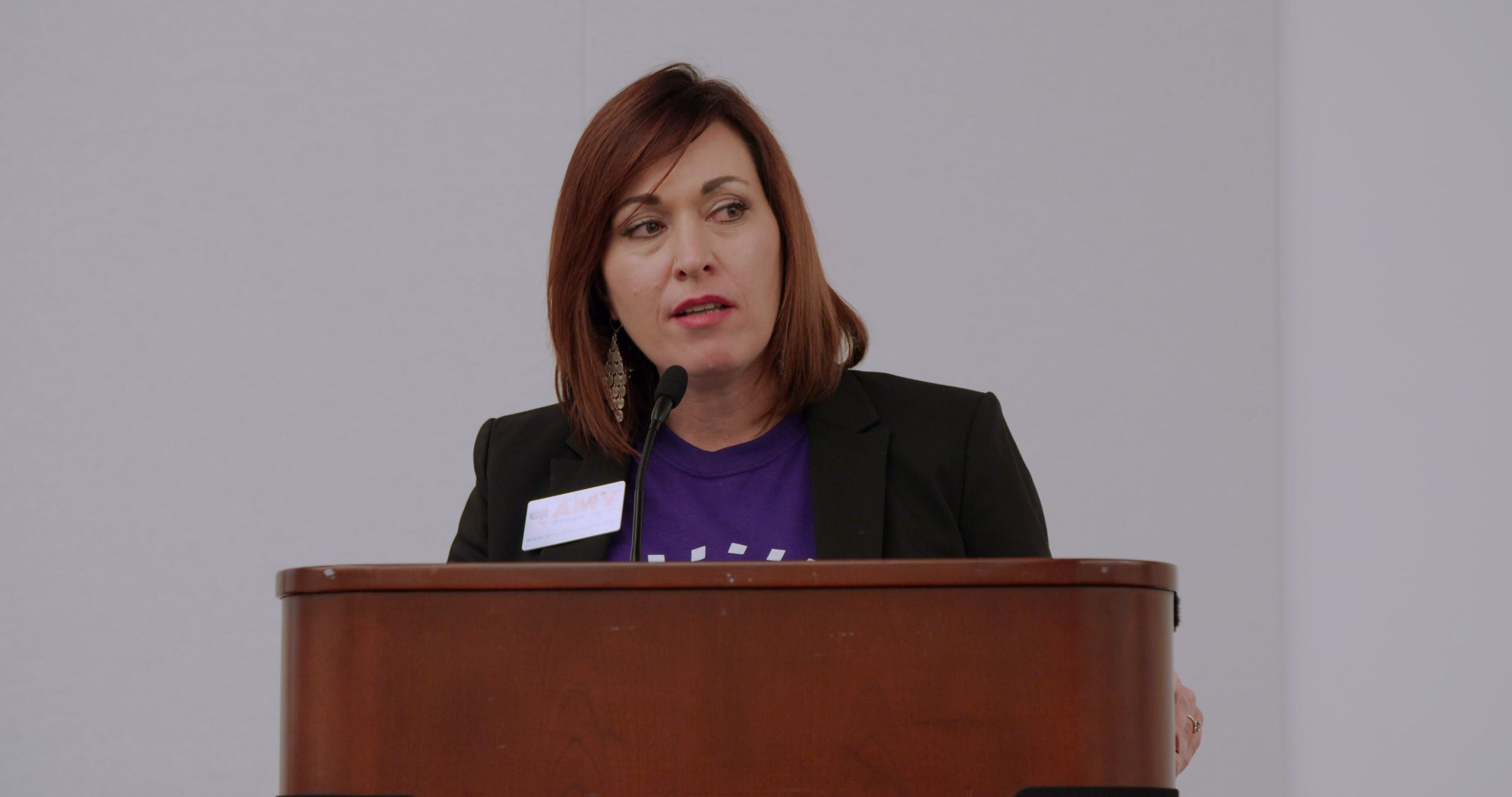 "Amy Vilela speaks at a Brand New Congress event, in a scene from ""Knock Down the House."""