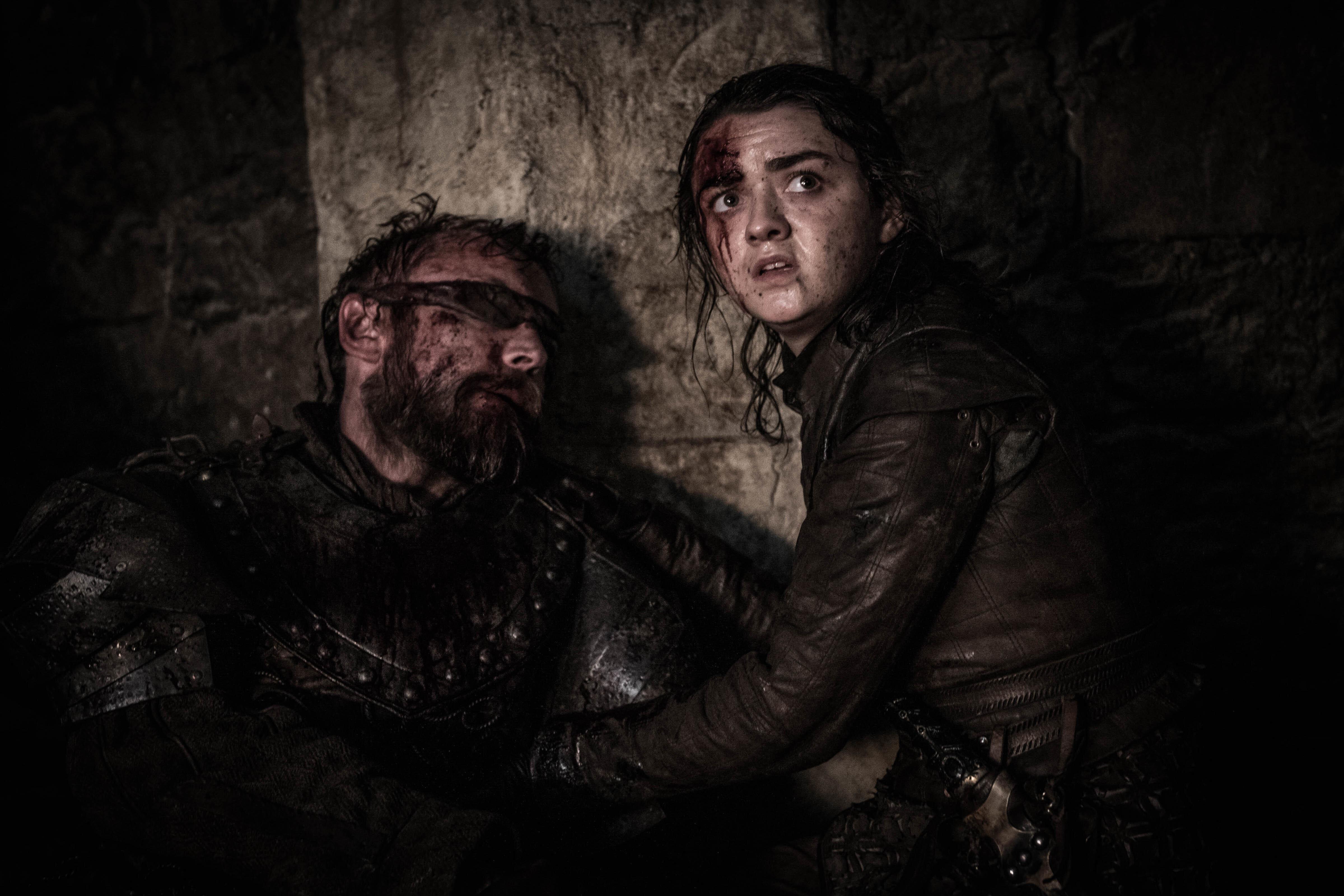 Arya Stark amid the destruction of Season