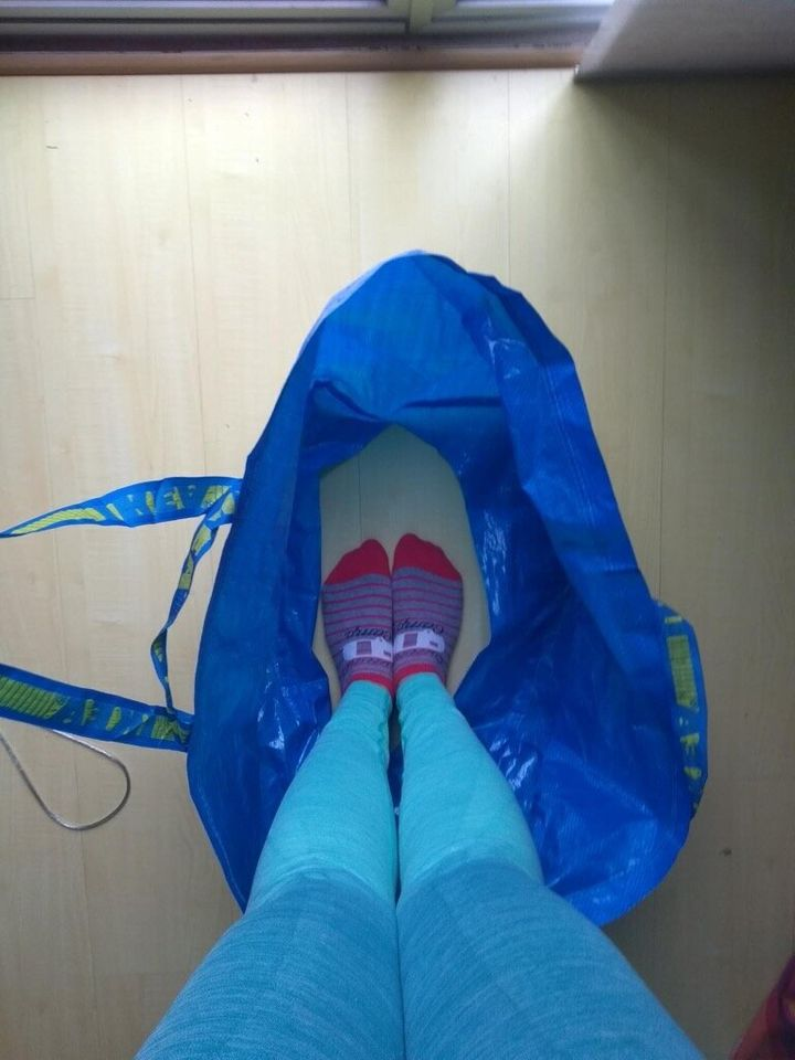 Tina said you should start by cutting a smallish hole in the bottom of the bag. It needs to be just large enough that your hips can fit through it. If the hole is too large, it won't function well.