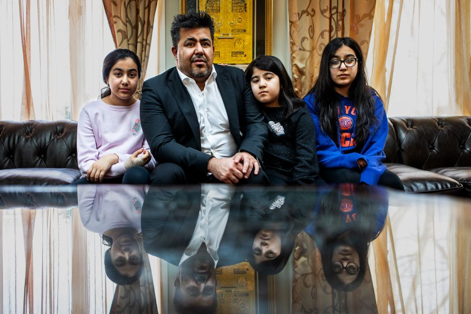 Omarkheil and his daughters in their home.He is worried he might have to sell his home if he doesn't...