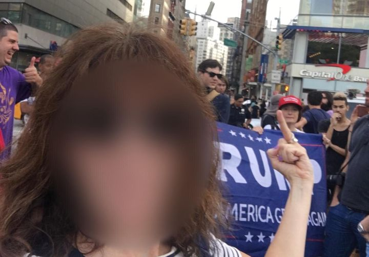 A woman shows her feelings toward the Trump supporters that showed up to an event organized by the Resisters, later revealed