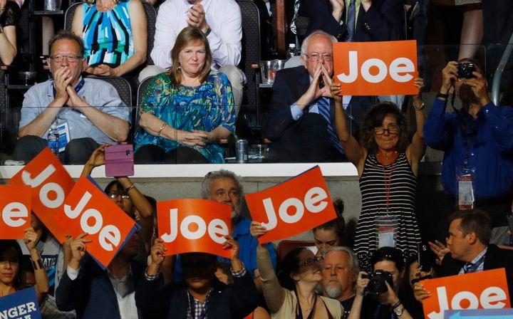 Sen. Bernie Sanders listens to a speech from then-Vice President Joe Biden at the 2016 Democratic National Convention.