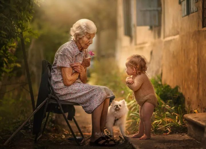 Just like grandma! A grandbaby mirrors her nana's posture.