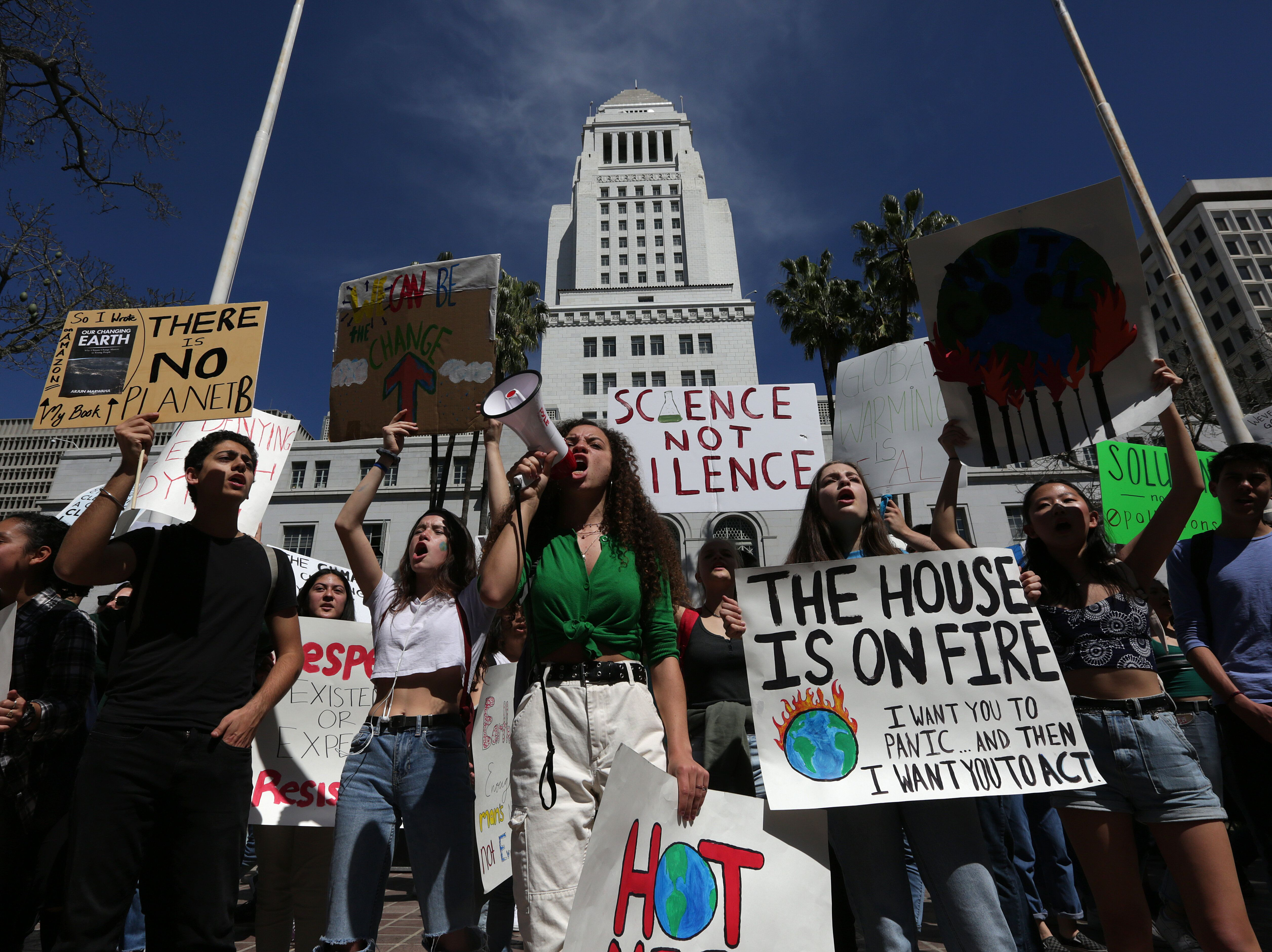 "LOS ANGELES, CA-MARCH 15, 2019: Los Angeles youth join a nationwide strike from school as they protest climate change and strike for the Green New Deal and ""other necessary actions to solve the climate crisis,"" at City Hall in downtown LA. (Photo by Katie Falkenberg/Los Angeles Times via Getty Images)"