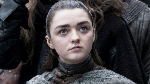 Maisie Williams in character as