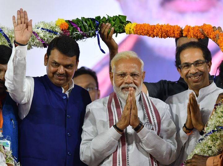 Prime Minister Modi, Shiv Sena president Uddhav Thackeray and Maharashtra CM Devendra Fadnavis during a rally in Maharashtra