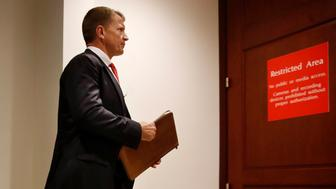 FILE - In this Nov. 30, 2017 file photo, Blackwater founder Erik Prince arrives for a closed meeting with members of the House Intelligence Committee on Capitol Hill in Washington. (AP Photo/Jacquelyn Martin)