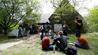 Swarthmore College students gather outside the Phi Psi fraternity house during a sit-in, Monday, April 29, 2019, in Swarthmore, Pa. Students at the suburban Philadelphia college have occupied the on-campus fraternity house in an effort to get it shut down after documents allegedly belonging to Phi Psi surfaced this month containing derogatory comments about women and the LGBTQ community and jokes about sexual assault. (AP Photo)