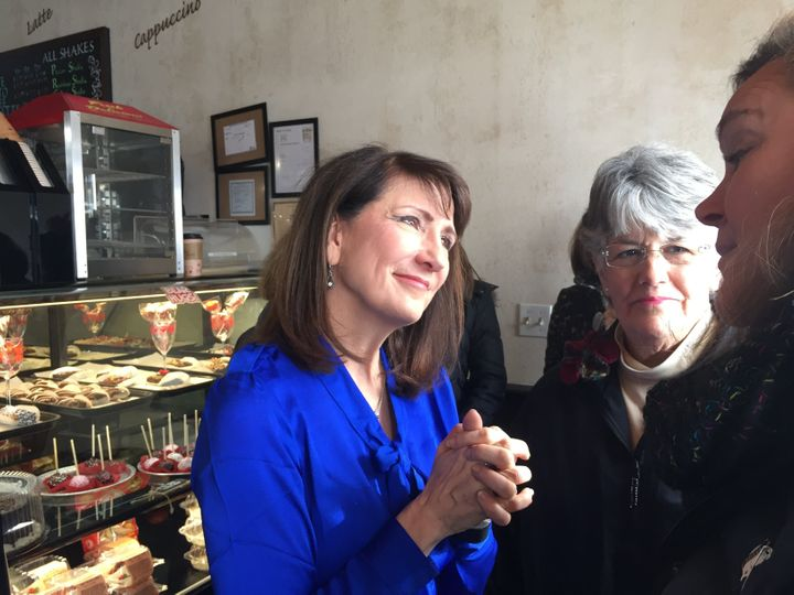 Marie Newman, left, speaks with supporters at a campaign event in Feb. 2018. The Democratic Party has tried to undercut her s