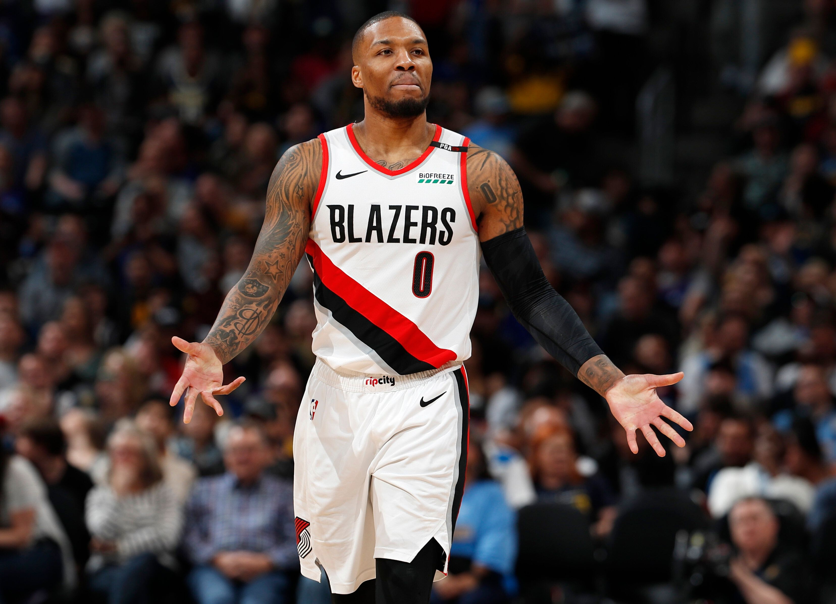 Portland Trail Blazers guard Damian Lillard reacts after being called for a foul against the Denver Nuggets during the second half of an NBA basketball game Friday, April 5, 2019, in Denver. The Nuggets won 119-110. (AP Photo/David Zalubowski)