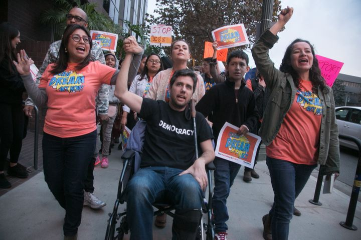 Ady Barkan (center) attends the Los Angeles Supports a Dream Act Now! protest  with actress Alyssa Milano and others at