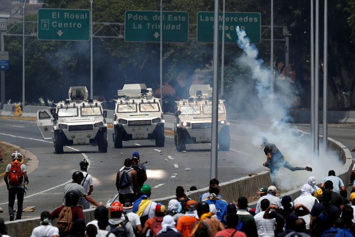 Demonstrators face off against armored vehicles during protests on Tuesday.