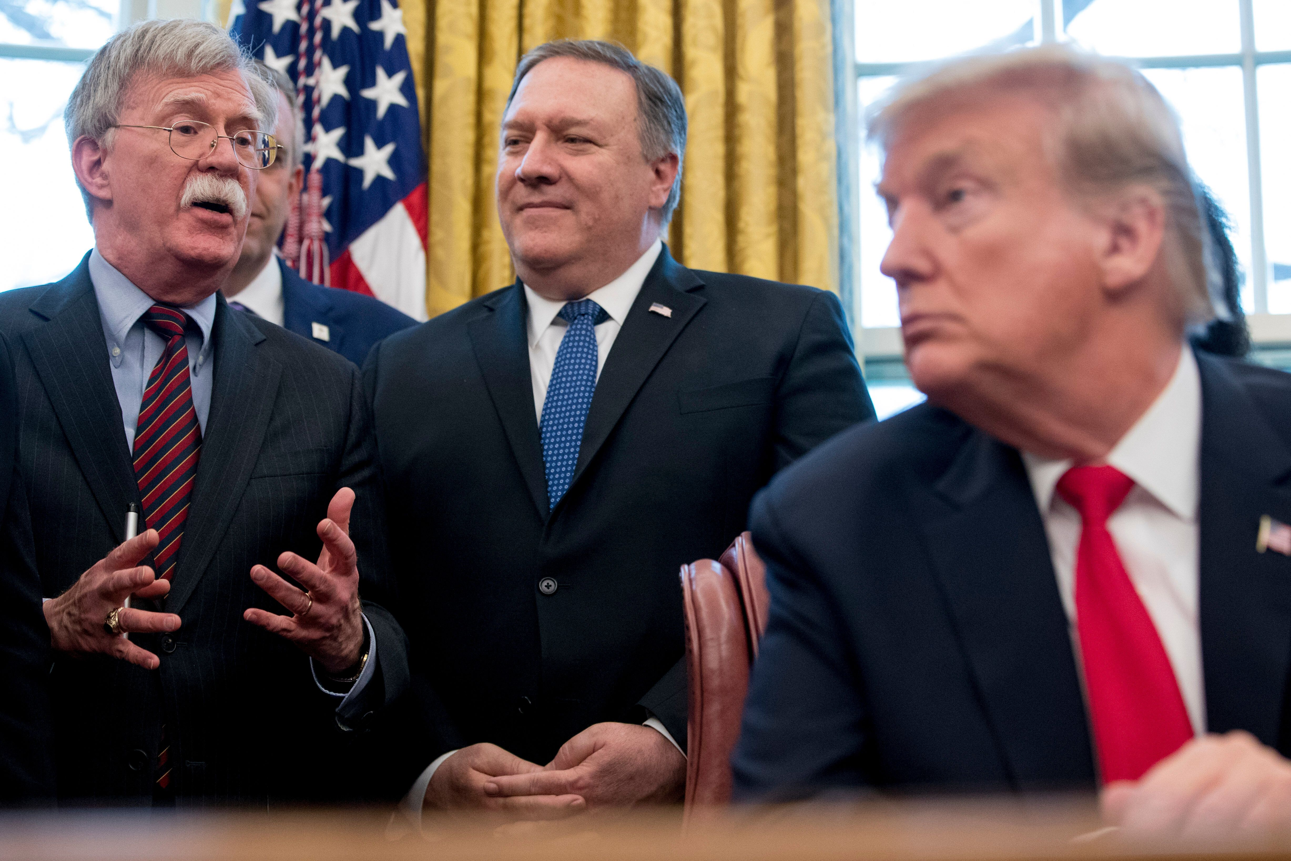National security adviser John Bolton, Secretary of State Mike Pompeo and President Donald Trump.