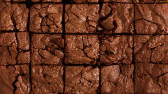 Pieces of freshly baked chocolate brownie viewed from above, chocolate cake background