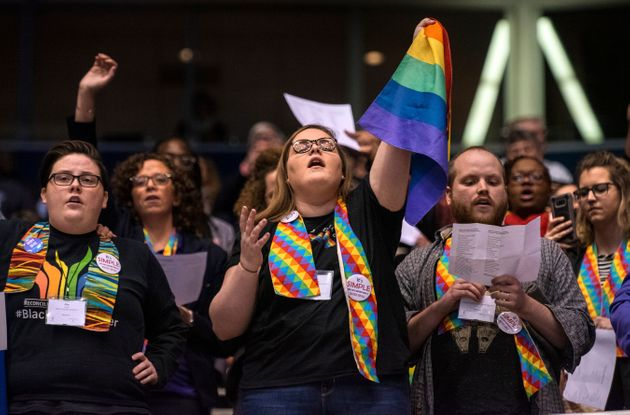 Protesters react after delegates to a United Methodist Church conferencemove to strengthen bans...