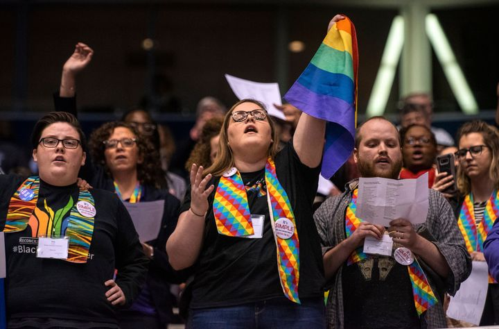 Protesters react after delegates to a United Methodist Church conference move to strengthen bans on same-sex marriage an