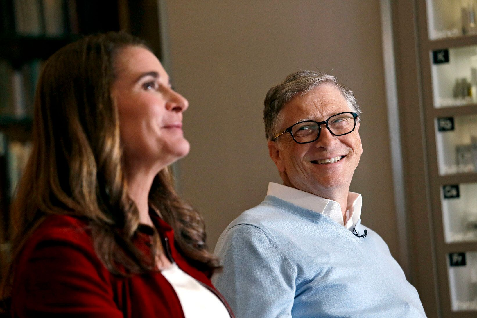 In this Feb. 1, 2019 photo, Bill Gates looks to his wife Melinda as they are interviewed in Kirkland, Wash. The couple, whose foundation has the largest endowment in the world, are pushing back against a new wave of criticism about whether billionaire philanthropy is a force for good. They said they're not fazed by recent blowback against wealthy giving, including viral moments at the World Economic Forum and the shifting political conversation about taxes and socialism. (AP Photo/Elaine Thompson)