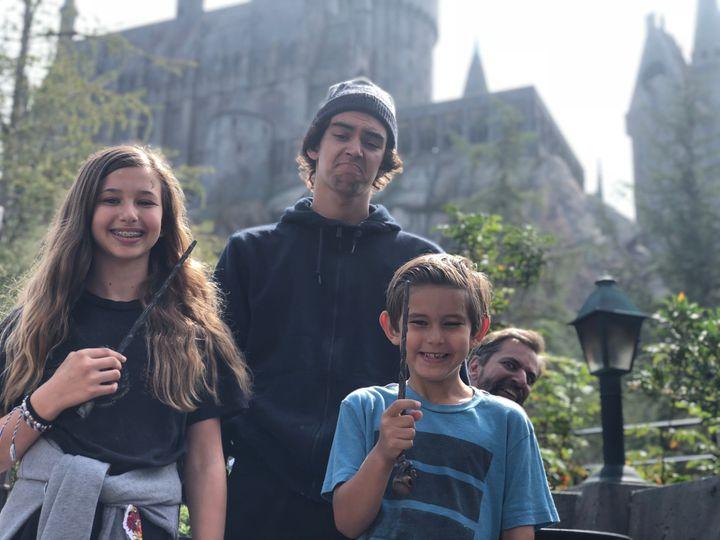 The Darnit Family: Johnna, AJ, Evan and Josh in the background.