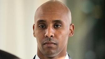 FILE - In this Friday, April 26, 2019, file photo, former Minneapolis police officer Mohamed Noor walks to court in Minneapolis. On Tuesday, April 30m 2019, a jury of 10 men and two women found Noor guilty of third-degree murder but acquitted of the more serious second-degree intentional murder. He also was convicted of manslaughter in the 2017 death of an unarmed Justine Ruszczyk Damond, a dual citizen of the U.S. and Australia. (Leila Navidi/Star Tribune via AP, File)