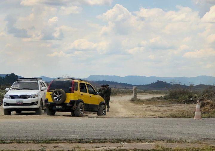 """Cars lined up at """"las trochas,"""" an unofficial route to Santa Elena de Uairén, Venezuela."""