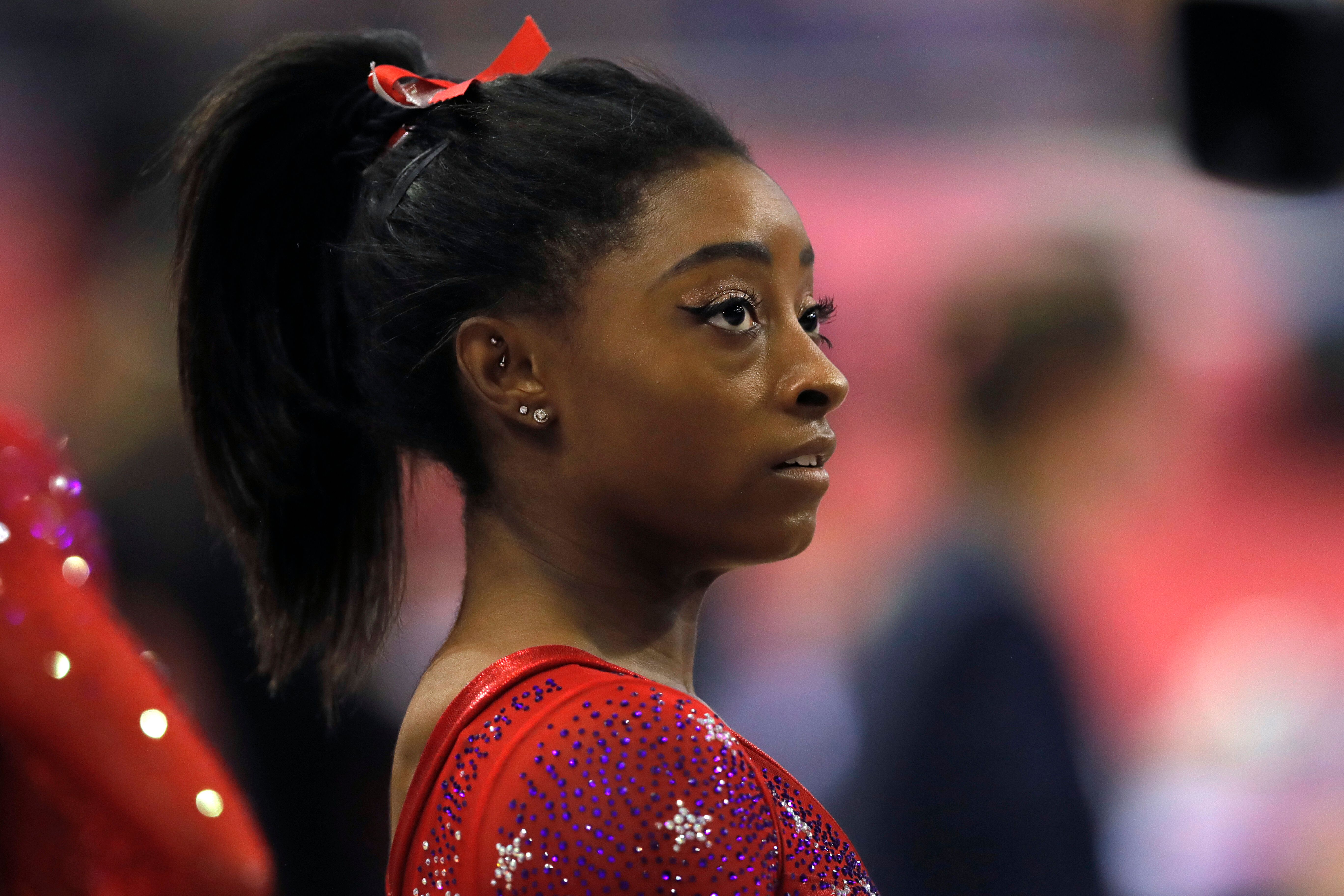 Simone Biles of the U.S. watches other athletes during the women's team final of the Gymnastics World Chamionships at the Aspire Dome in Doha, Qatar, Tuesday, Oct. 30, 2018. (AP Photo/Vadim Ghirda)