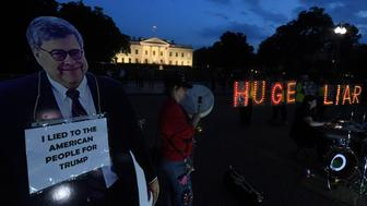 "Protesters hold up letters that reads ""Huge Liar"" beside a cardboard cutout of Attorney General William Barr ahead of Barr's appearance before the Senate Judiciary Committee, following the release of the Mueller report, in front of the White House in Washington, U.S., April 30, 2019. REUTERS/Clodagh Kilcoyne"