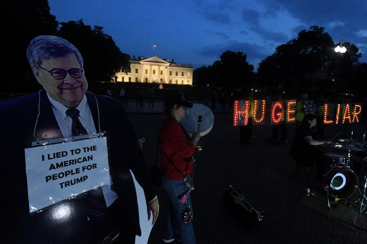 Protesters at the White House on Tuesday night before Attorney General William Barr's scheduled appearance before the Senate