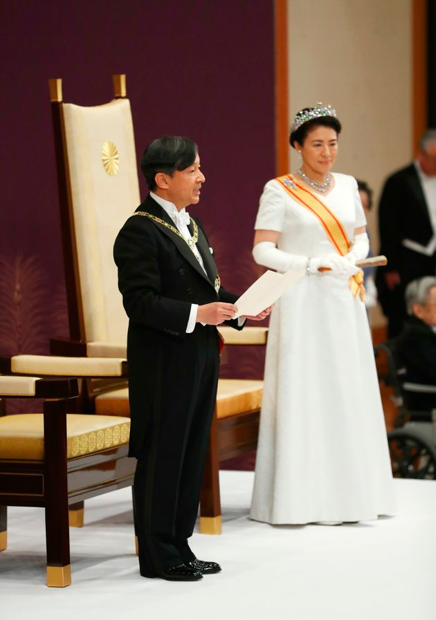 Japan's new Emperor Naruhito, accompanied by new Empress Masako, makes his first address during a ritual...