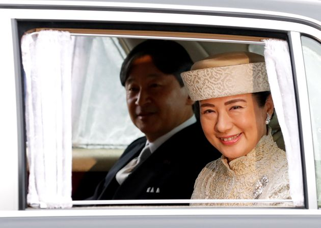 Japan's Crown Prince Naruhito and Crown Princess Masako arrive at the Imperial Palace, where Emperor...