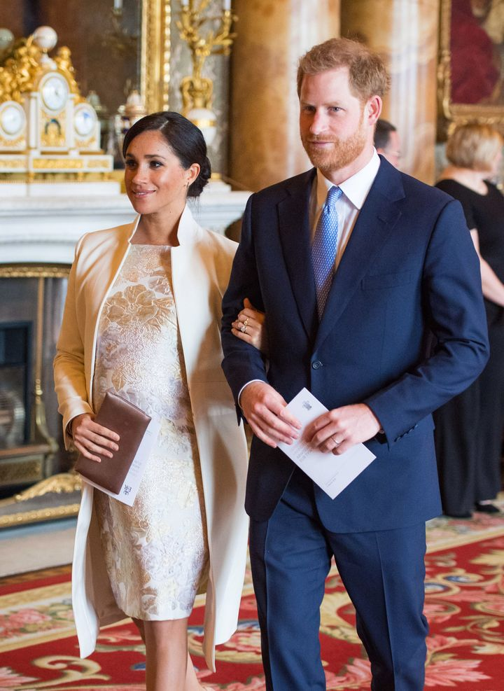 Meghan, Duchess of Sussex and Prince Harry attend a reception to mark the 50th anniversary of the investiture of the Prince o