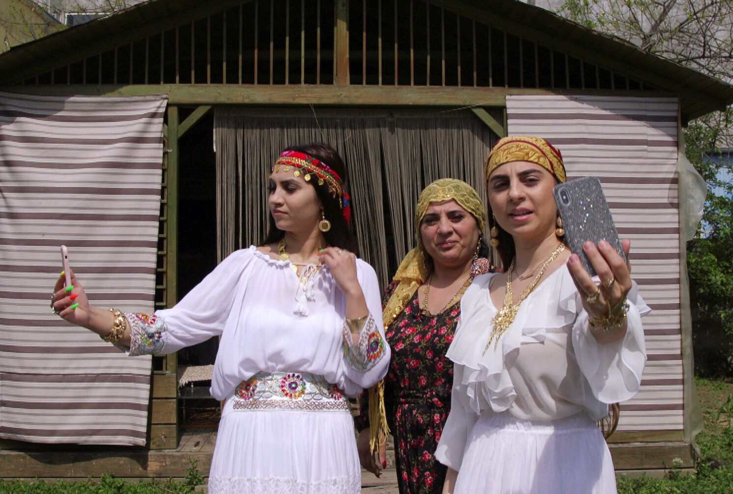 A family of Romanian witches livestream a ritual on Facebook for their followers, in Mogosoaia near Bucharest, Romania April 25, 2019. Picture taken April 25, 2019. REUTERS/Emily Wither