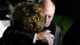 UNC Charlotte Chancellor Philip DuBois receives a hug after a news conference regarding a deadly shooting on the campus earlier in the day, Tuesday, April 30, 2019, in Charlotte, N.C. (David T. Foster III/The Charlotte Observer via AP)